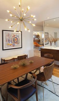 At left: A 24-light Sputnik chandelier—named for the Russian satellite—hangs above the dining room table in this mid-century modern home in Wilmington. The built-in floating buffet is an original.