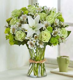 Bring some calm to someone special in your life. Inspired by the beauty of nature, our subtle, charming arrangement is hand-designed with the freshest blooms in delicate shades of green and white, arranged in a classic gathering vase tied with raffia. Easter Flower Arrangements, Easter Flowers, Beautiful Flower Arrangements, Flower Centerpieces, Floral Arrangements, Beautiful Flowers, 800 Flowers, Flowers Today, White Flowers
