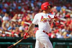 ST. LOUIS, MO - SEPTEMBER 1: Kolten Wong #16 of the St. Louis Cardinals hits a game-tying solo home run in the seventh inning against the Pi...