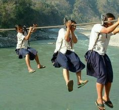 Girls on the way to school in remote Nepal. There is no bridge and they have to risk their lives daily for an education. So many others risk to go to school. Here in us we cant hardly get kids to go to school We Are The World, People Of The World, Schools Around The World, Around The Worlds, Walk To School, School Today, High School, Brave Girl, Thinking Day
