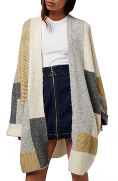 Stay cozy with this open-front cardigan knit from Topshop! It features mixed weaves in a magnified color-blocked design, dropped shoulders, and a long hemline.