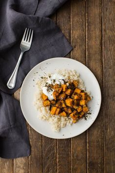 An easy lunch with roasted za'atar sweet potatoes, couscous, and a simple lemon yogurt.