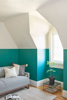 Half painted walls in a bold teal - works with this angled ceilings! Vardo Paint by Farrow & Ball