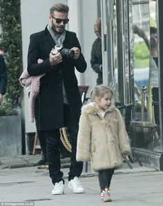 Doting father David Beckham snaps pictures of Harper, three #dailymail