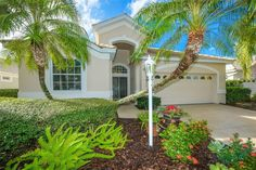 Tucked inside the maintenance-free, gated community of and framed by mature palm trees and colorful tropical landscaping, this home is perfect for you! Reclaimed Water, Residential Security, Garage Dimensions, Lakewood Ranch, Basement Pool, Stucco Exterior, Lake Water, Tropical Landscaping, Great Restaurants