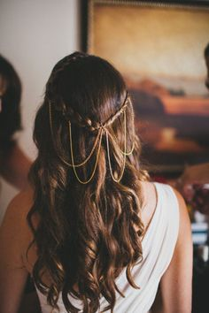 Long wedding hairstyle with necklaces / jewelry as decoration.