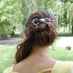 This is such a pretty up-do style! Her hair is secured with a beautiful silver and mother of pearl flexi clip with long flowing curls left loose to drape over her shoulder