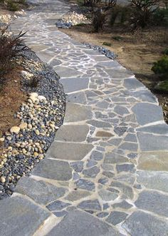 stone walkway with pebble edging