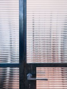 Sadie Snelson Architects have used a refined material palette of steel, timber, concrete & pale lime washed walls in this incredible warehouse conversion. Reeded Glass, Steel Doors And Windows, Crittall, Warehouse Conversion, Glass Structure, Steel Columns, Door Detail, Window Detail, Patio Interior