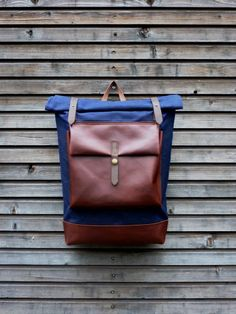Image of Waxed canvas rucksack/backpack with roll up top and oiled leather bottem COLLECTION UNISEX