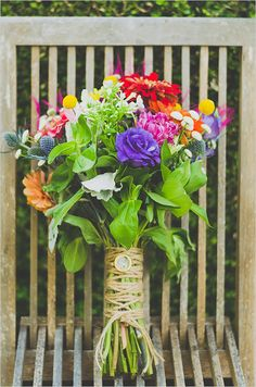 colorful wedding bouquet wrapped in twine.