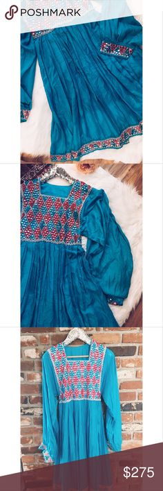 "Vtg70s Boho Embellished Peasant Gypsy Maxi Dress S This is a gorgeous Vtg 70s peasant bohemian Embellished Maxi oversized sleeve dress. Turquoise color. Sleeve length 27""/ bust 32""/ waist 15""/ hips 30""/ dress length 42.5."" Dress ties on back. cotton, silk and other materials. Mirror-like with blue and pink Embroidery. Embellishments are on front chest, bottom hemline and sleeve cuffs. Gently used and in great vintage condition. 052117 Vintage Dresses Maxi"