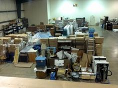 Our warehouse after a pack out. We can inventory, pack out, clean, deodorize, store, and pack back your contents after a fire. 888-364-1188