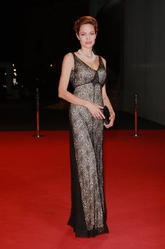Pin for Later: 52 Reasons to Celebrate Angelina Jolie's Red Carpet Evolution Angelina Jolie's Red Carpet Transformation She was elegant in black and cream in 2007.