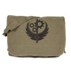 """Ransack the wastelands in search of technology with this stylish messenger bag. Army Green Vintage Canvas Paratrooper Bag with the Brotherhood of Steel logo screenprint on the front flap.  3 Inner Compartments 1 Outer Compartment w/ Snaps Brass Hardware 1"""" Wide Adjustment Shoulder Strap Dimensions: 15"""" x 11"""" x 4"""""""