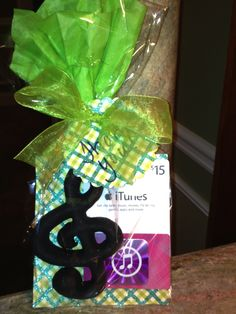 Music teacher- thank you gift:  paper mache' treble clef painted black with iTunes gift card.