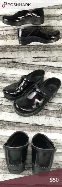 Dansko Black Patent Leather Professional Clogs Dansko brand   Size women's 39 (8.5-9) Closer to a 9 - I wear an 8.5 and they're too big for me.   Black patent leather professional slip on clog.   Comfortable and durable!   Good preowned condition- these do show some cosmetic wear - one shoe shows moderate toe creasing & shoe wrinkling, the other shoe shows a small circle of missing finish on the toe and a scuff by the trim.  The footbed shows minor wear and the soles show minor wear.  They…