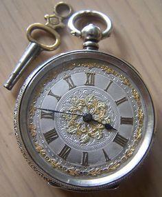 antique ornate pocket watch