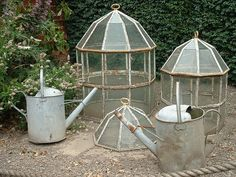 These fellas could be free hanging, maybe a bar running from wall to wall across the void in the Yarden/ neighbours wall, then there won't be the issue with leaves in the drain. Cloches & cans--would love to find some of these old victorian cloches.