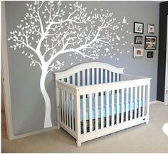 A life sized white tree wall decal looks fantastic against any color painted wall for a forest, bird, nature, theme baby room.