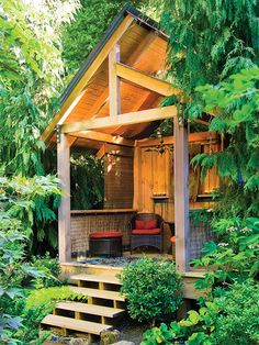 This small backyard bungalow is the perfect nook to spend an intimate evening. Simple furniture and an antique chandelier make this a sophisticated adult spot rather than a children's playhouse. (Photo: Jon Jensen)