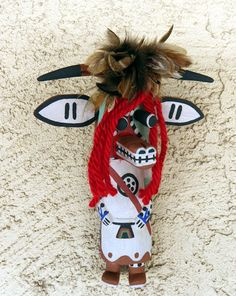 Territorial Indian Arts  Traditional Hopi Cow Kachina is carved by Kevein Chavarria of First Mesa.