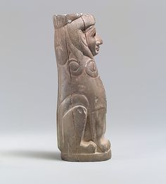 Furniture support: female sphinx with Hathor-style curls,middle bronze age,old Assyrian Trading Colony.  ca 18th century BC  Anatolia.  Ivory bone.