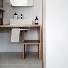 Towel rail mounted under timber in powder room