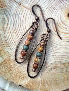These are awesome. ~Nate from http://rings-things.com Natural stone beads framed by lightly-hammered wire #handmade #jewelry #earrings