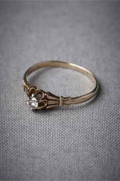 Possession Ring $850.00. Art-deco-ish band. Pretty little thing.