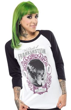 ROCK REBEL BRIDE OF FRANKENSTEIN RAGLAN TEE Have a scream of time with this Bride of Frankenstein shirt from Rock Rebel! Featuring a white body and black 3/4 sleeves this shirt is the only one you'll need to capture the heart of your mish-mashed together monster man! $25.00 NEED THIS SHIRT