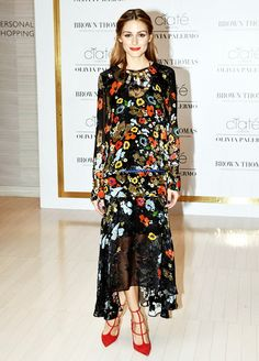 Olivia Palermo wears a floral dress, crystal collar, gold cuff, and Christian Louboutin strappy pumps