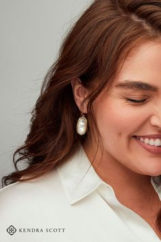 Featuring our most signature of custom stones in an oval metallic frame, the Elle Rose Gold Drop Earrings in Ivory Mother-of-Pearl are true classics. Loved for their versatile style, these Drop earrings can be dressed up or down with ease. No matter what you're wearing, the Elle Rose Gold Drop Earrings will add the perfect finishing touch to your look. #SilverDropEarrings