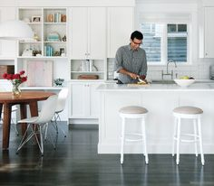 Good example of a shaker kitchen with a solid island bench. Love the colour of the floorboards
