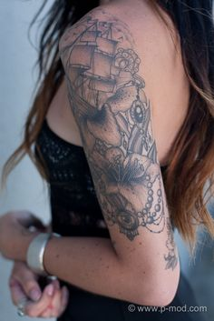 my arm. tiger lilies, tentacles, pearls, a boat and an eye.
