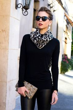 Using animal print scarf to brighten up monochromatic black outfit. Sweater. Leather leggings