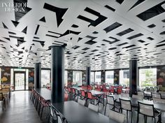 "Beneath the cafeteria's laser-cut MDF ceiling, spelling out ""Enjoy your meal"" in four languages, Alberto Meda chairs pull up to his tables. InteriorDesign:Nov2012"