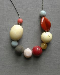 I'm really liking necklaces with different size and color beads/stones.