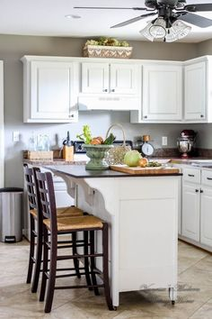 …that looks instantly modern after a few coats of grey on the walls and a few coats of white on the cabinets. | 19 Kitchen Makeover Before-And-Afters That Will Make Your Jaw Drop