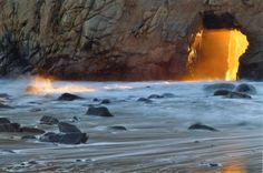 {{{Light}}} coming from hole in rocks at Pfeiffer Beach, Big Sur, California