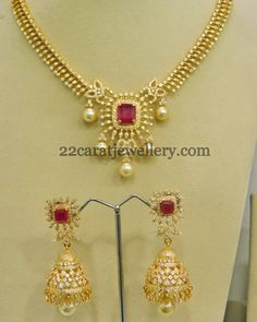 Image from http://3.bp.blogspot.com/-T6EsesiVBUI/VDKg2cSs5AI/AAAAAAACWgg/0T29aBBgdu8/s1600/CZ-necklace-with-jhumkas-in-diamond-setting.jpg.