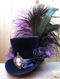 Tiny Top Hat / Mini Top Hat / Purple Velvet / Cameo / Feathers Love mini top hats, they are so awesome! Steampunk Hut, Moda Steampunk, Steampunk Costume, Victorian Steampunk, Steampunk Fashion, Victorian Hats, Steampunk Necklace, Steampunk Clothing, Steampunk Top Hat