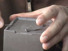 Putting feet on a square tea pot.  This is an excellent video, a little long, though...