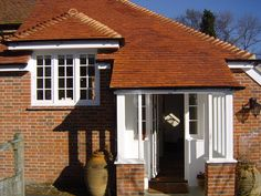 Painted windows, entrance door and porch Timber Windows, Entrance Doors, Surrey, Joinery, Porch, Cabin, London, House Styles, Outdoor Decor