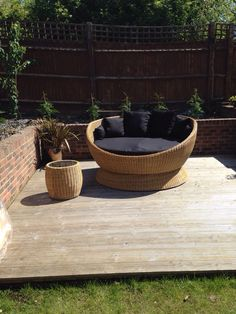 A satisfied customer with the Outdoor Swivel Bed on their patio