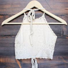 FINAL SALE Cream colored halter crochet crop top that features a tie neck and back. Fully lined. Imported. Digging the boho vibe.  Seen styled with our floral kimono jacket, antalya turkish coin collar, black booties, and black distressed high waisted shorts. All sold separately.