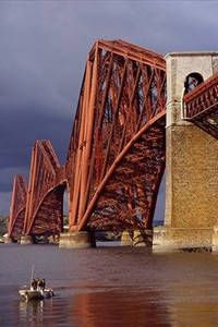 The Forth Bridge in Scotland. Construction started in 1883 and took seven years to build. It's construction cost the lives of 63 men.