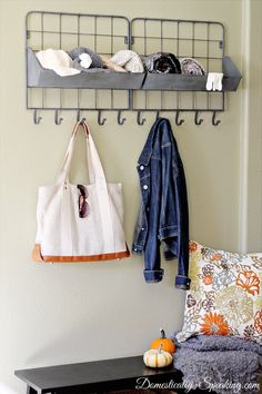 For over the Side Board hanging guest coats .. industrial storage bin/hooks reminds me of a feed mill