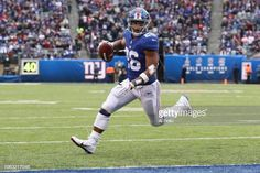 e57c5191f56 Running back Saquon Barkley of the New York Giants runs the ball to score a  touchdown against the Tampa Bay Buccaneers in the first quarter at MetLife  ...