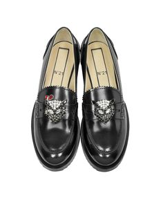 New Air Black Leather Women's Loafer crafted in natural smooth calfskin has a feminine punk style with a clean look and goes great with casual or formal wear. Featuring slip-on design, rounded toe, leather upper, penny strap, crystal cat head embellishment on vamp, stacked heel and leather sole. N21 collection.